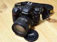 Nikon D750 DSLR camera with 24-120 mm lens